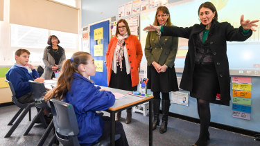 NSW Premier Gladys Berejiklian (right), Member for East Hills Wendy Lindsay (middle) and Education Minister Sarah Mitchell at Panania Public School south-west of Sydney.