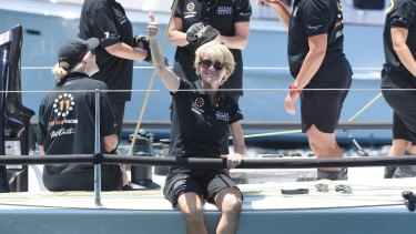 Julie Bishop gives onlookers the thumbs up as she prepares to jump off Wild Oats X.
