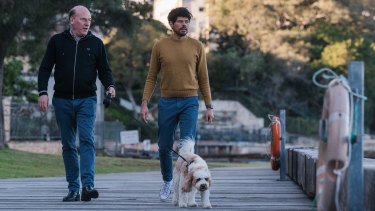 Federal Liberal MP Trent Zimmerman with partner Carlos Toledo and their dog Simba at Sawmillers Reserve in McMahons Point.