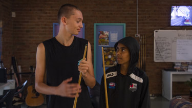 James and Malikye, both 14, playing pool at the Aboriginal family wellbeing program in Wyoming on the Central Coast.