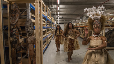 Nani Crichton, Miracle Temareti and Ashleigh Malama Pritchard of the Matavai Cultural Dance group view some of the 40,000 objects from Pacific collection in storage in Rydalmere.