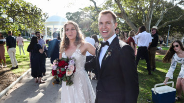 I do in a hurry: Sophie and Anders Ridley-Smith just managed to squeeze in their wedding vows on Sunday before Balmoral Beach was cleared.