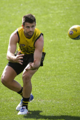 In sure hands: Richmond captain Trent Cotchin is returning to the game this weekend.