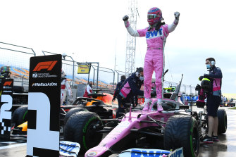 Lance Stroll celebrates pole position in Turkey.