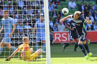 Victory captain Ola Toivonen heads his second goal past City goalkeeper Tom Glover in round 11.
