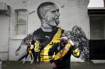 Paying tribute: Josh Rowe and children Madeline and Archie at the Lushsux mural of Richmond footballer Dustin Martin in Kelso Street, Richmond.