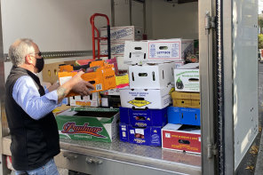 Trucks loaded at Prahran Market with produce donated by Reliable Fruit, to go to the Asylum Seeker Resource Centre.