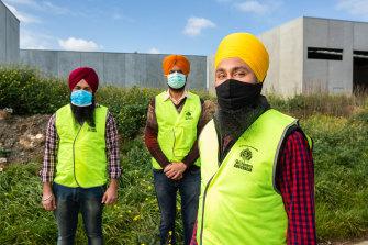 Sikh Volunteers Australia workers (from left) Simranjit Singh, Avtar Singh and Manpreet Singh.