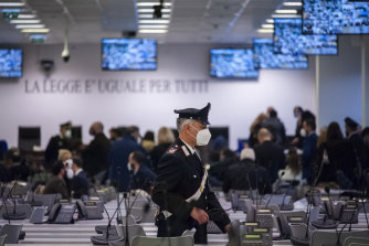 A Carabinieri police officer walks inside a specially constructed bunker ahead of the first hearing of a maxi-trial against more than 300 defendants of the 'ndrangheta crime syndicate, near the Calabrian town of Lamezia Terme, southern Italy.