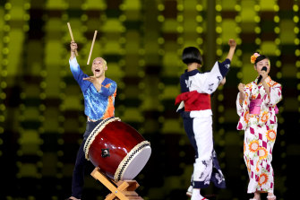 Entertainers perform a traditional song at the closing ceremony of the Tokyo Games.