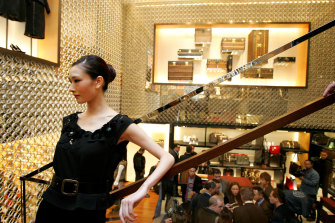 A model poses on a stairway at the opening of a Louis Vuitton store in Beijing in 2005.