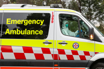 An ambulance drives out of the Anglicare Newmarch House at Caddens in Sydney's west.