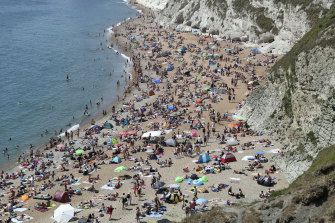 People on the beach near Lulworth in Dorset, England on Saturday.