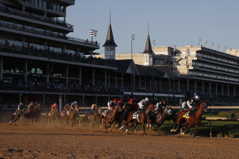 Authentic, with John Velazquez in the saddle, leads the Kentucky Derby field past the first turn en route to an upset win at Churchill Downs.