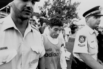 Diego Maradona is escorted off Wentworth Park after training with the Argentinian team in 1993.