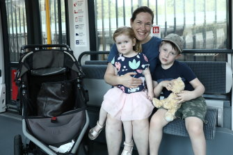 Paula Moylan with her children, Hugh and Audrey, on the light rail on Saturday.