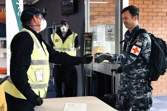 Australian Defence Force and Australian Medical Assistance team members arrive at Burnie Airport.