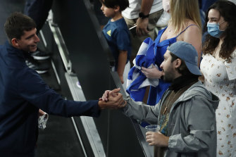 Greek player Michail Pervolarakis greets fans during day four of the 2021 ATP Cup on February 5 in Melbourne.