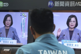 A Taiwanese man watches the Democratic Progressive Party leader Tsai Ing-wen speak during a policy address.
