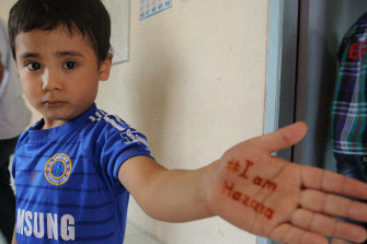 An Afghan asylum seeker child at a learning centre in Indonesia in 2014 after Australia stopped the boats.