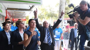 Former PM John Howard walked the streets of Burwood with Liberal candidate Fiona Martin.