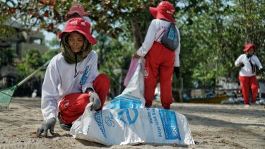 Wayan Sarta and 14 colleagues were first funded by Coca Cola a decade ago to clean the beach daily.
