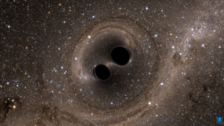 An artist's impression of two black holes merging.