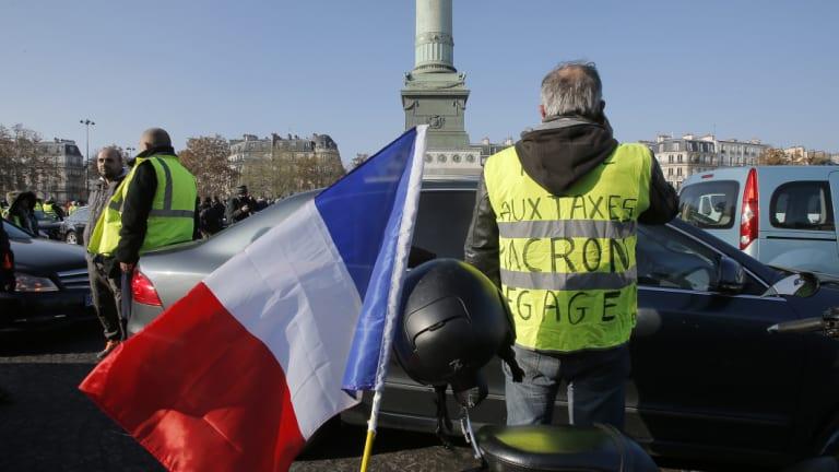 Yellow vest Protesters block the Place de la Bastille to protest against fuel taxes in Paris, France, on November 17.