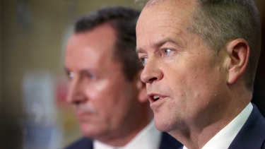 Opposition Leader Bill Shorten outlines his promise to match the federal government's GST deal, with WA Premier Mark McGowan at South Metro Tafe Carlisle campus on Wednesday.