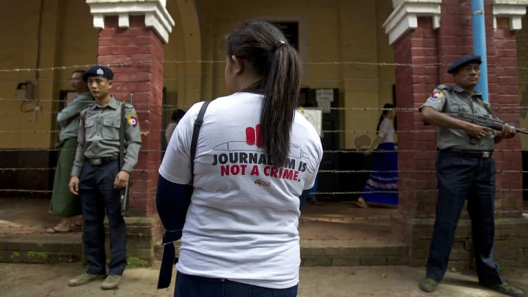 A journalist stands outside the court during the trial of Reuters journalists Wa Lone and Kyaw Soe Oo, who were sentenced to seven years in prison.