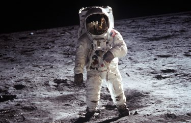 Buzz Aldrin's helmet face cover reflects Apollo 11 commander Neil Armstrong taking his picture on the lunar surface.