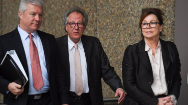 Geoffrey Rush arriving at court with wife Jane Menelaus on Monday.