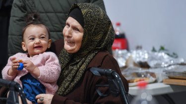 Feriha Emirali, 84, celebrates Eid, the end of the fasting month of Ramadan, with great granddaughter Meryem Deniz,1.