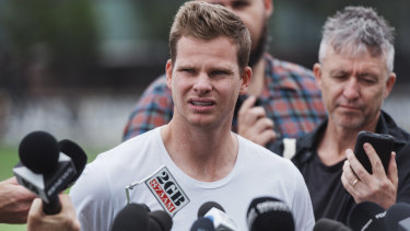 Hold the phone: Steve Smith talks to the press in Sydney on Friday.
