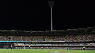 The lights on the grandstand at the Stanley Street end of the Gabba were out on Thursday night.