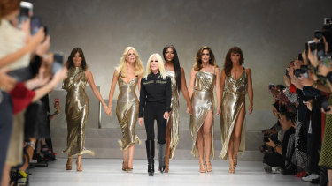 Donatella Versace leads Carla Bruni, Claudia Schiffer, Naomi Campbell, Cindy Crawford and Helena Christensen down the catwalk at Milan Fashion Week last September.