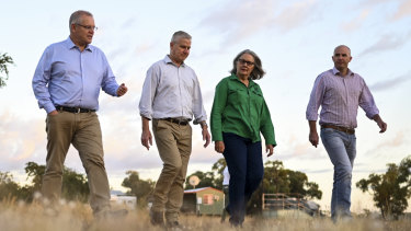 Prime Minister Scott Morrison and Deputy Prime Minister Michael McCormack speak to farmer Jacqueline Curley at Gipsy Plains Station near Cloncurry.