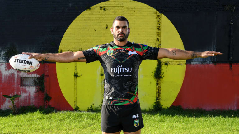 True colours: Greg Inglis poses against an Aboriginal flag in Redfern for the NRL's Indigenous round.