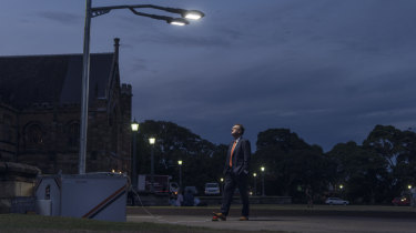 Thomas Maschmeyer, professor of chemistry at the University of Sydney, activates lamps on his campus powered by his new Gelion battery.