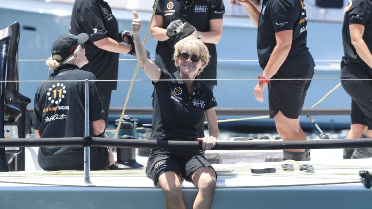 Julie Bishop gives onlookers the thumbs up as she prepares to jump off Wild Oats X
