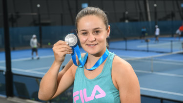 Ashleigh Barty with her second Newcombe Medal at Melbourne Park on Tuesday.