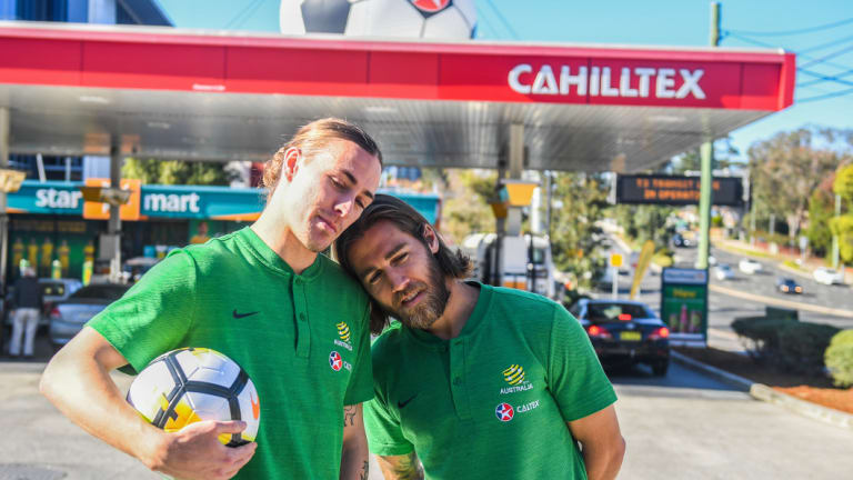 Fuelling controversy: Jackson Irvine and Josh Brilliant pose outside a Tim Cahill-themed Caltex.