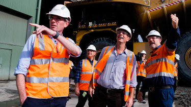 Treasurer Dominic Perrottet, Nationals' leader John Barilaro and Upper Hunter Nationals' candidate David Layzell at the Ravensworth open cut coal mine, north of Singleton.