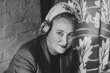 Frances Burke dressed for work in 1952.