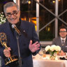 "Eugene Levy accepts the outstanding lead actor in a comedy series award for ""Schitt's Creek"" as his son and castmate Dan Levy looks on."