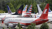 Dozens of grounded Boeing 737 MAX plans crowd a parking area in Seattle. Are there other Boeing models with software problems?