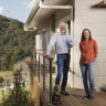 Tony and Teresa Farrell, at the Narara housing community, on the NSW Central Coast: they estimate that their greener house will save them $2000 a year.