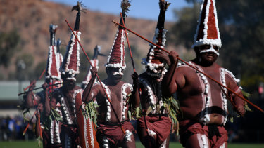 Ceremonial: Indigenous dancers perform before the start of round 18 in the Red Centre.