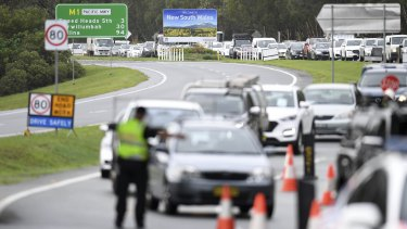 Vehicles queued up at a police checkpoint at the Queensland/NSW border in Coolangatta on Monday.