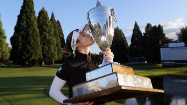 Hannah Green poses with the oversized trophy after winning the Portland Classic.